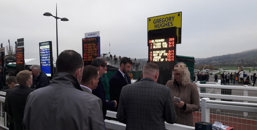 bookies paying out winning bets at cheletnham racecourse