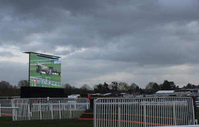 big screen behind final fence at cheltenham racecourse